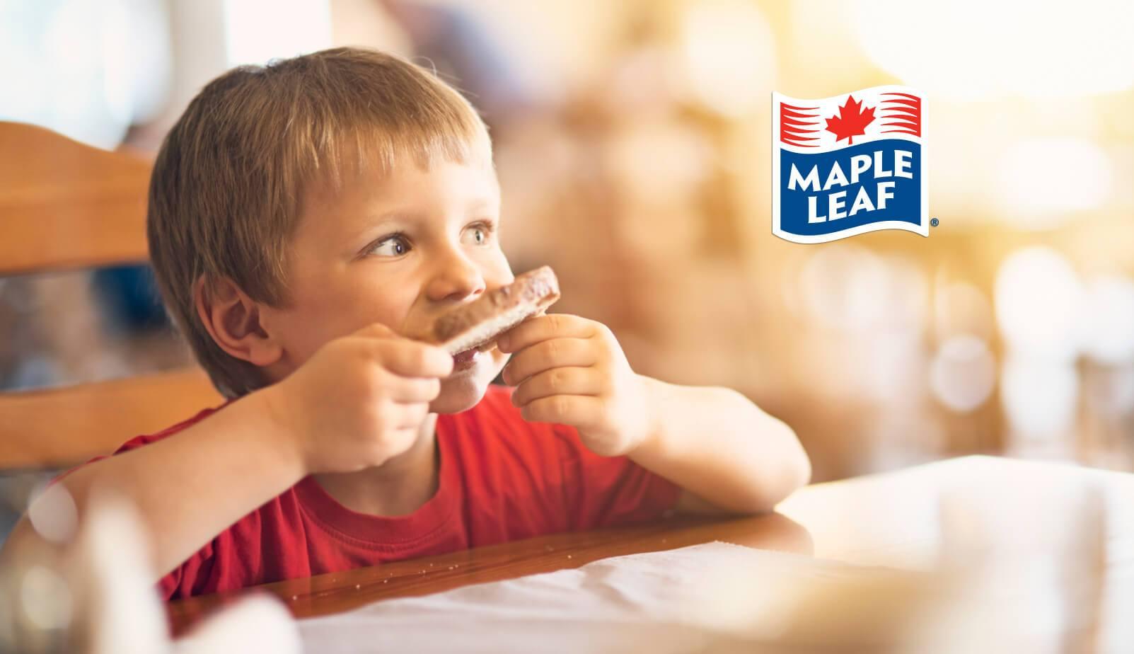 Kid eating a toast
